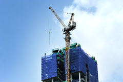 Building crane and building under construction Royalty Free Stock Photo