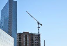 Building crane and building under construction Royalty Free Stock Image