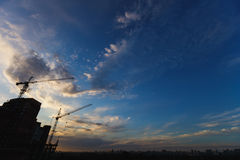 Building crane and building under construction against blue sky Royalty Free Stock Image