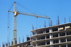Building crane and building under construction Stock Photography