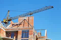 Building crane and building under construction Stock Image