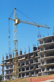 Building crane and building under construction Stock Images