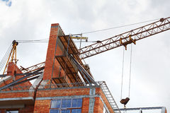 Building crane and building under construction Royalty Free Stock Photos