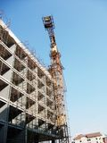 Building with crane. Built house construction with crane Royalty Free Stock Photo