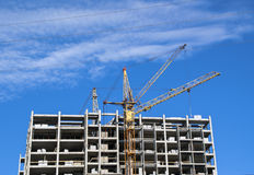 Building crane is constructing high building Stock Photography