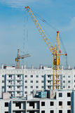 Building and crane construction. File building and crane construction site. High-rise buildings Royalty Free Stock Image