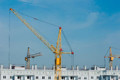 Building and crane construction. File building and crane construction site. High-rise buildings Stock Images