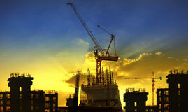 Building and crane construction site against beaut Stock Image