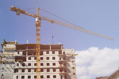 Building crane on construction site Royalty Free Stock Image