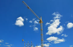 Building crane on construction site. Building high rise. Royalty Free Stock Photo