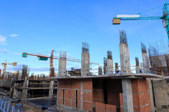 Building crane and construction site under blue sky Stock Photography