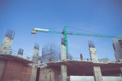 Building crane and construction site under blue sky Royalty Free Stock Photos