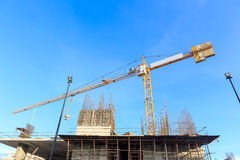 Building crane and construction site under blue sky Royalty Free Stock Photo