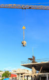 Building crane and construction site under blue sky Stock Images