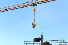 Building crane and construction site under blue sky Stock Image