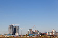 Building crane and construction site under blue sky. Building crane and construction site under blue sky stock images