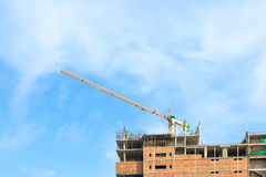 Building crane and construction site under blue sky Royalty Free Stock Photography