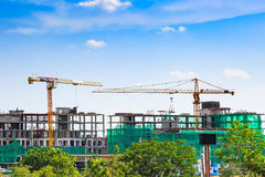 Building crane and construction site under blue sky Royalty Free Stock Image