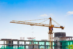 Building crane and construction site under blue sky Royalty Free Stock Images