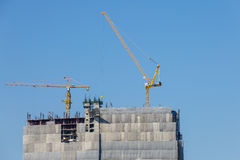Building crane and construction site under blue sky Stock Photo