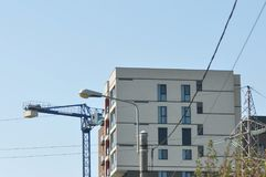 Building with crane. Detail of flats building with crane stock image
