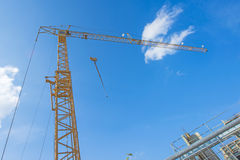 Building crane with house construction Stock Photo