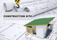 Building crane with house and sketches Royalty Free Stock Photos