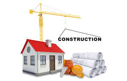 Building crane with house and sketches Stock Images