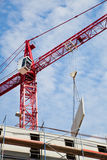 Building crane with prefab wall. Building crane with a prefab wall at a construction site Royalty Free Stock Photos