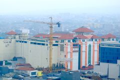 Building with crane on the side. Show that construction work happening there. This is Pasar Baru building, in Bandung, Indonesia Stock Photography