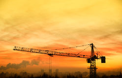 Building crane at sunrise Royalty Free Stock Images