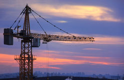 Building crane at sunset Royalty Free Stock Photos