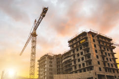 Building crane at sunset and building an orange sky. Building crane at sunset and building an orange sky Stock Photography