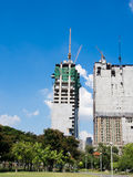 Building crane and two building under construction Stock Images
