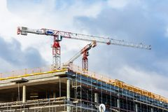 Construction site with crane and building against blue sky Royalty Free Stock Images