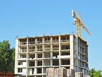 Building crane under construction site Stock Image
