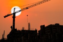 Building and crane under construction. With sunrise or sunset  sky background Stock Images
