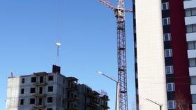 Building crane works stock footage
