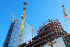 Building with cranes. On sky background Royalty Free Stock Image