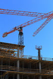 Building with Cranes, Arrow shape. Building with Cranes, Construction tools Royalty Free Stock Photos