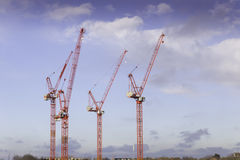 Building Cranes. And Blue Sky Stock Photography