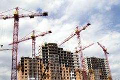 Building cranes and  building under construction Royalty Free Stock Image
