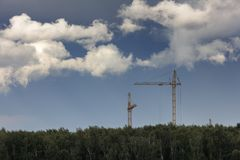 Building with Cranes Stock Photography