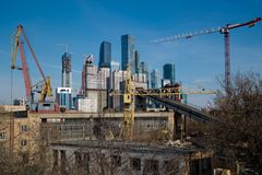 Building and cranes under construction royalty free stock image