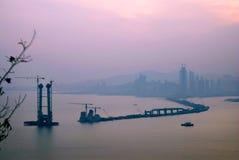 Building Cross Sea Bridge. Under sunset glow Dalian, China Stock Photos