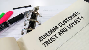 Building customer trust and loyalty. Printed on white book stock photography