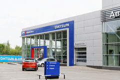 Building of Datsun car selling and service center with Datsun sign. Ulyanovsk, Russia - July 20, 2016: Building of Datsun car selling and service center with royalty free stock images
