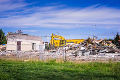 Building demolishion. Edmonton, Canada, August 16, 2016: Crew is clearing a path for the new light rail transport line in city of Edmonton, Alberta Royalty Free Stock Images