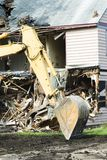 Building demolition 12. The demolition of a wood frame building to make room for commercial development Royalty Free Stock Image