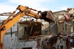 Building demolition. Mechanical shovel being used to demolish a building on an urban renewal project Royalty Free Stock Photos